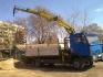 камион с кран предлага транспортни услуги...